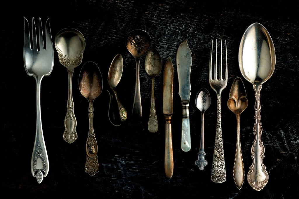 Blacked silver spoons and forks