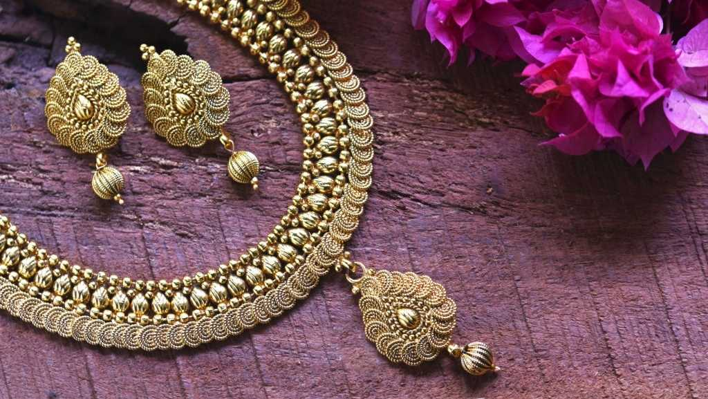 Gold Jewellery - a necklace with a pair of earrings