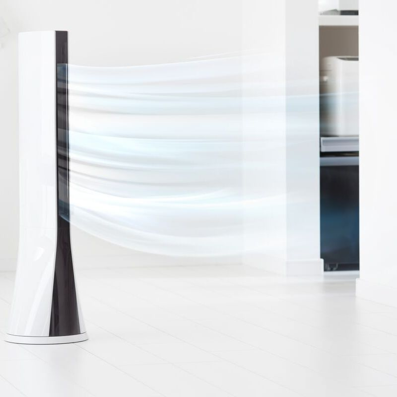 Image of a tower fan throwing air around the room